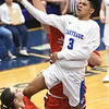 Carthage's Arkell Smith (3) drives past West Plains' Jake Swope (0) and draws the foul on Garel McGinley, left, during their consolation semifinal game in the Carthage Invitational on Friday night at Carthage.<br /> Globe | Laurie SIsk