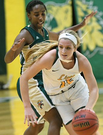 Missouri Southern's Chelsey Henry (15) gets past Missouri S&T's Joe'l Bland during their game on Tuesday night at Leggett & Platt.<br /> Globe | Laurie Sisk