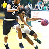 Missouri Southern's CJ Carr (0) drives past Lincoln's Maurice Mason (3) during their game on Thursday night at Leggett & Platt.<br /> Globe | Laurie Sisk
