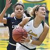 Missouri Southern's Dru Clark (1) drives past Lincoln's Citlali Lopez during their game on Thursday night at Leggett & Platt.<br /> Globe | Laurie Sisk