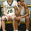 Cyprus Falls' Nigel Hawkins, right, catches his breath on the bench beside teammate Zach Stephenson during their game on Saturday night in Neosho.<br /> Globe | Laurie Sisk