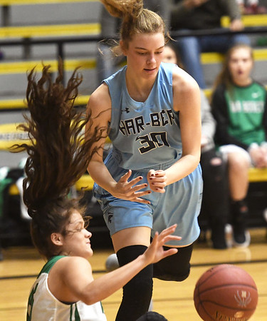 Har Ber's Sophie Nelson (30) and Van Buren's Irasema Sandoval battle for a loose ball during their championship game of the Neosho Holiday Classic on Saturday night at Neosho High School.<br /> Globe | Laurie Sisk