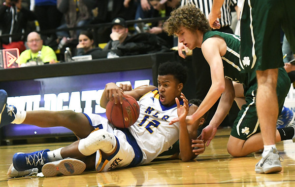 North Little Rock's Moses Moody (12) lands on top of St. Joseph Lafayette's Diego Bernard as he and Tyson Koch (right) battle for a loose ball during their championship game of the Neosho Holiday Classic on Saturday night at Neosho High School.<br /> Globe | Laurie Sisk