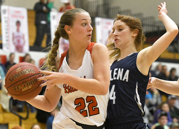 Carl Junction's Kate Dreiling (22) looks for an open teammate as Galena's Lyndsey Dixon (4) defends during their game on Friday night at Carl Junction.<br /> Globe | Laurie Sisk