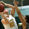 Missouri Southern's Desirea Buerge (21) drives the lane as Lindenwood's Gabby Walker (20) defends during their game on Saturday at Leggett & Platt.<br /> Globe | Laurie Sisk