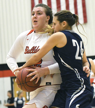 Carl Junction's Megan Scott drives to the basket as Galena's Paige Jensen (24) defends during their game on Friday night at Carl Junction.<br /> Globe | Laurie Sisk