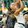 Missouri Southern's Dru Clark (1) is fouled driving to the basket by Lindenwood's Lexi Moe (33) during the Lions' come-from-behind victory on Saturday at Leggett & Platt.<br /> Globe | Laurie Sisk