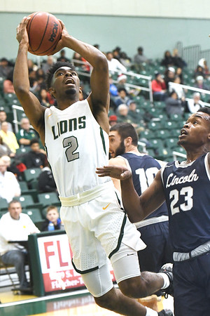 Missouri Southern's Koray Gilbert (2) drives past Lincoln's Amariontez Ivory (23) during their game on Thursday night at Leggett & Platt.<br /> Globe | Laurie Sisk