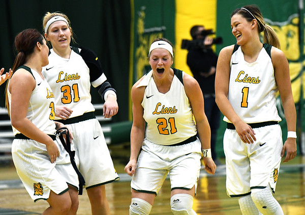 From the left: Missouri Southern players Julianna Wadsworth (3), Jenson Maydew (31), Desirea Buerge (21) and Dru Clark (1) celebrate their come-from-behind victory over Lindenwood on Saturday at Leggett & Platt.<br /> Globe | Laurie Sisk