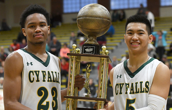 From the left: Cyprus Falls players and Houston residents Nigel HAwkins and Andrew Nguyen hold their third place trophy after the game on Saturday night in Neosho.<br /> Globe | Laurie Sisk