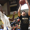 Neosho's A.C. Marion puts up a shot Neosho's Brady Wise (2) as Kansas City Ruskin's Isaiah Williams (32) defends during their opening game of the 2017 Neosho Holiday Classic on Wednesday at NHS.<br /> Globe | Laurie Sisk