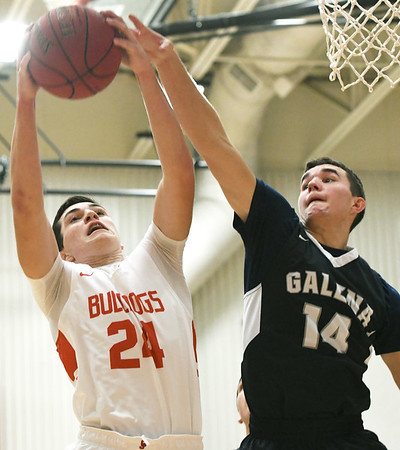 Carl Junction's Alex Baker (24) drives to the basket as Galena's Garrett Hall (14) defends during their game on Friday night at Carl Junction.<br /> Globe | Laurie Sisk