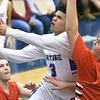 Carthage's Arkell Smith (3) drives past West Plains' Jake Swope (0) during their consolation semifinal game in the Carthage Invitational on Friday night at Carthage.<br /> Globe | Laurie SIsk
