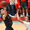 Joplin's Austin Higdon (22) scores over Webb City's Tanner Rogers (12) during their game on Tuesday night at Webb City.<br /> Globe | Laurie Sisk