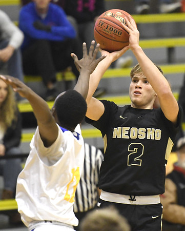 Neosho's Brady Wise (2) puts up a shot as Kansas City Ruskin's Willie White (11) defends during their opening game of the 2017 Neosho Holiday Classic on Wednesday at NHS.<br /> Globe | Laurie Sisk