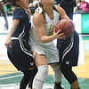 Missouri Southern's Desirea Buerge (21) splits Lincoln defenders Citlali Lopez, left, and  Kailey Foster during their game on Thursday night at Leggett & Platt.<br /> Globe | Laurie Sisk