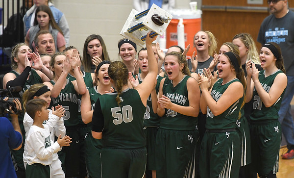 The Mount Vernon High School girls basketball team celebrates its first place finish in the 71st Annual Carthage Invitational on Saturday at Carthage High School.<br /> Globe | Laurie Sisk