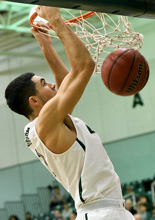 Missouri Southern's Kinzer Lambert throws down a dunk off of a CJ Carr assist during the Lions' game against Lindenwood on Saturday at Leggett & Platt.<br /> Globe   Laurie Sisk