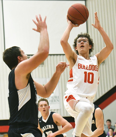 Carl Junction's Brendon Hoberecht (10) drives to the basket as Galena's Trevor Little defends during their game on Friday night at Carl Junction.<br /> Globe | Laurie Sisk