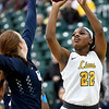 Missouri Southern's Chasidee Owens (22) sinks a jump shot as Illinois-Springfield's Ellie Mitchell defends during their game on Wednesday afternoon at Leggett & Platt.<br /> Globe | Laurie Sisk