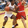 Joplin's Evan Guillory (21) looks to get past McDonald County's Saul Garcia (35) during their game on Friday night at Kaminsky Gymnasium.<br /> Globe | Laurie Sisk