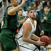 Missouri Southern's Enis Memic (12) eyes the basket as Northeastern State's Aaron Givens (23) defends during their game on Saturday at Leggett & Platt.<br /> Globe | Laurie Sisk