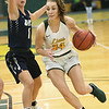 Missouri Southern's Krista Clark (34) drives the lane as Illinois-Springfield's Lauren Ladowski (1) defends during their game on Wednesday afternoon at Leggett & Platt.<br /> Globe | Laurie Sisk