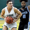 From the left: Missouri Southern's Kinzer Lambert gets past Upper Iowa's Peghuentz Pericles during their game on Wednesday afternoon at Leggett & Platt.<br /> Globe | Laurie Sisk