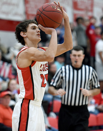 Baxter Springs senior Trey White hits a shot behind the arc during the Lions game against Galena on Tuesday night at BSHS.<br /> Globe | Laurie Sisk