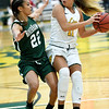 Missouri Southern's Amber Buch (11) looks for an open teammate as Northeastern State's Maegan Lee (22) defends during their game on Saturday at Leggett & Platt.<br /> Globe | Laurie Sisk