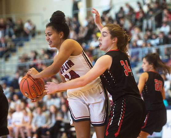 Joplin's Serafina Auberry makes a pass under pressure from Blue Valley West's Neva Longhofer during Thursday's Freeman Lady Eagle Classic at Joplin High School.<br /> Globe | Roger Nomer