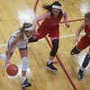 Joplin's Gabriella Quinn drives against Aurora's Chloe Ryan (12) and Brooke Schutte (22) during Monday's game at Joplin High School.<br /> Globe | Roger Nomer