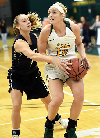 Missouri Southern's Chelsey Henry (15) drives the lane as Illinois-Springfield's Lauren Ladowski defends during their game on Wednesday afternoon at Leggett & Platt.<br /> Globe | Laurie Sisk