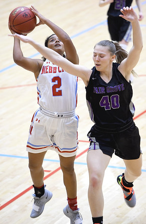 Webb City's Keira Jackson (2) puts up a shot as Fair Groves' Alana Findley (40) defends during their game on Thursday night at Webb City.<br /> Globe | Laurie Sisk
