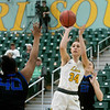 Missouri Southern's Krista Clark puts up a shot between Culver-Stockton's Dominique Broadus (40) and Payton Curley (21) during Monday's game at Leggett and Platt Athletic Center.<br /> Globe | Roger Nomer