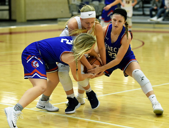 Seneca's Chaney Platner (2) and Taylor Mailes (23) trap Joplin's Grace Ipsen (10) during their game on Friday night at Kaminsky Gymnasium.<br /> Globe | Laurie SIsk