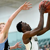 Missouri Southern's Elyjah Clark scores as Upper Iowa's Kyle Haber defends during their game on Wednesday afternoon at Leggett & Platt.<br /> Globe | Laurie Sisk