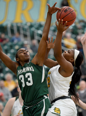 Missouri Southern's Chasidee Owens (22) drives the lane as Northeastern State's Joi Bertrand (33) defends during their game on Saturday at Leggett & Platt.<br /> Globe | Laurie Sisk