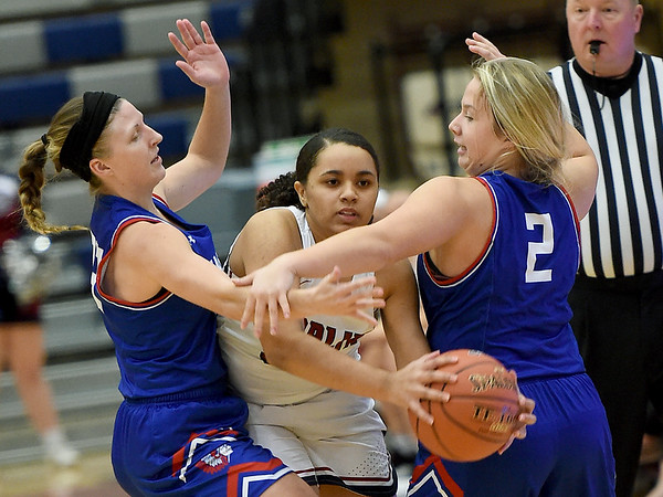 Joplin's Dayleigh Smith (32) tries to break the press as Seneca's Taylor Mailes (23) and Chaney Platner (2) defend during their game on Friday night at Kaminsky Gymnasium.<br /> Globe | Laurie SIsk