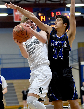 College Heights' Connor Burton (22) drives the lane as Forsyth's Jordan Letterman (34) defends during their game on Tuesday night at Ozark Christian College.<br /> Globe | Laurie Sisk
