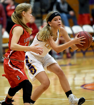 From the left: Thomas Jefferson's Cyra Evans (11) looks for an open teammate as Sheldon's Madison Garren (5) defends during their game on Thursday night at Thomas Jefferson.<br /> Globe | Laurie Sisk