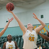 Missouri Southern's Jordan Schoenberger pulls down a rebound between Culver-Stockton's Ryan Dooley (11) and Dominique Broadus (40) during Monday's game at the Leggett and Platt Athletic Center.<br /> Globe | Roger Nomer