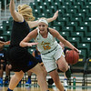 Missouri Southern's Chelsey Henry drives around Culver-Stockton's Sydney Neuner during Monday's game at the Leggett and Platt Athletic Center.<br /> Globe | Roger Nomer