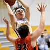 Thomas Jefferson's Dylan Dean Heck (14) shoots over Sheldon's Jason Leavell (23) during their game on Thursday night at Thomas Jefferson.<br /> Globe | Laurie Sisk