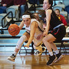 Joplin's Brynn Driver dribbles around Blue Valley West's Olivia Legate during Thursday's Freeman Lady Eagle Classic at Joplin High School.<br /> Globe | Roger Nomer