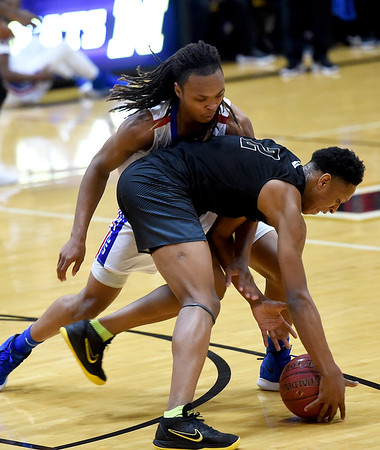 West Memphis' Terry Burgess, rear and Memphis Mitchell's Jamarious Horten (2) battle for a loose ball during their championship game in the boys gold division of the Neosho Holiday Classic on Saturday at Neosho High School.<br /> Globe | Laurie Sisk