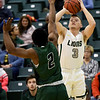 Missouri Southern's Parker Jennings (3) puts up a shot as Northeastern State's Montrey Thomas Jr. (2) defends during their game on Saturday at Leggett & Platt.<br /> Globe | Laurie Sisk