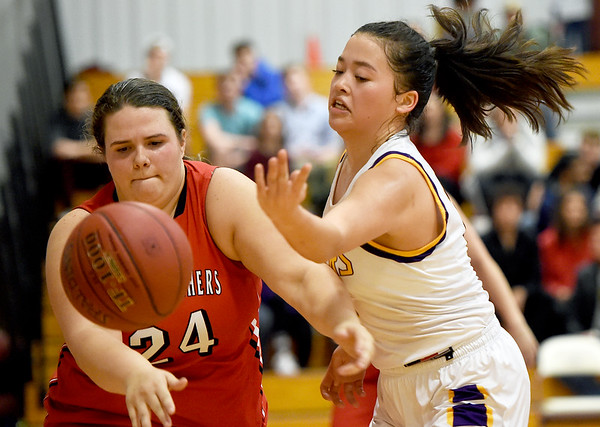 Thomas Jefferson's Sonia Carlson (12) and Sheldon's Brooklynn O'Connor (24) scramble for a loose during their game on Thursday night at Thomas Jefferson.<br /> Globe | Laurie Sisk