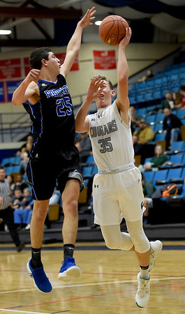 College Heights' Skyler Levendosky (35) shoots as Forsyth's Trevor Turner (25) defends during their game on Tuesday night at Ozark Christian College.<br /> Globe   Laurie Sisk
