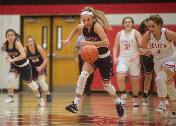 Joplin's Gabriella Quinn chases down a loose ball against Seneca during Monday's Carl Junction Classic.<br /> Globe | Roger Nomer